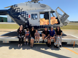 Aveling team in front of Police Helicopter